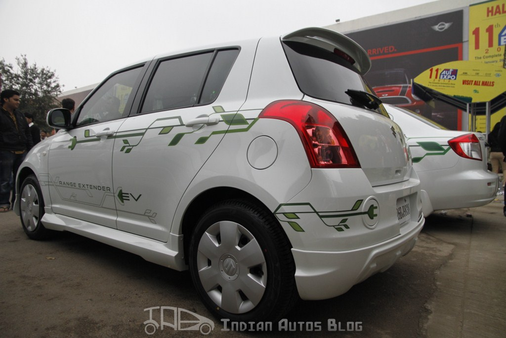 Maruti Swift hybrid rear three quarters