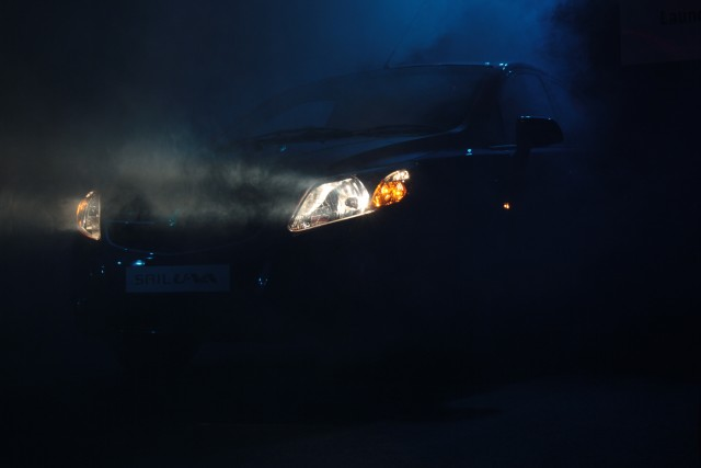 Chevrolet Sail emerges through a cloud of smoke