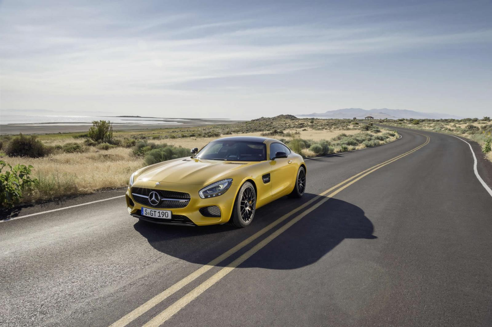 Mercedes AMG GT press image yellow front three quarter