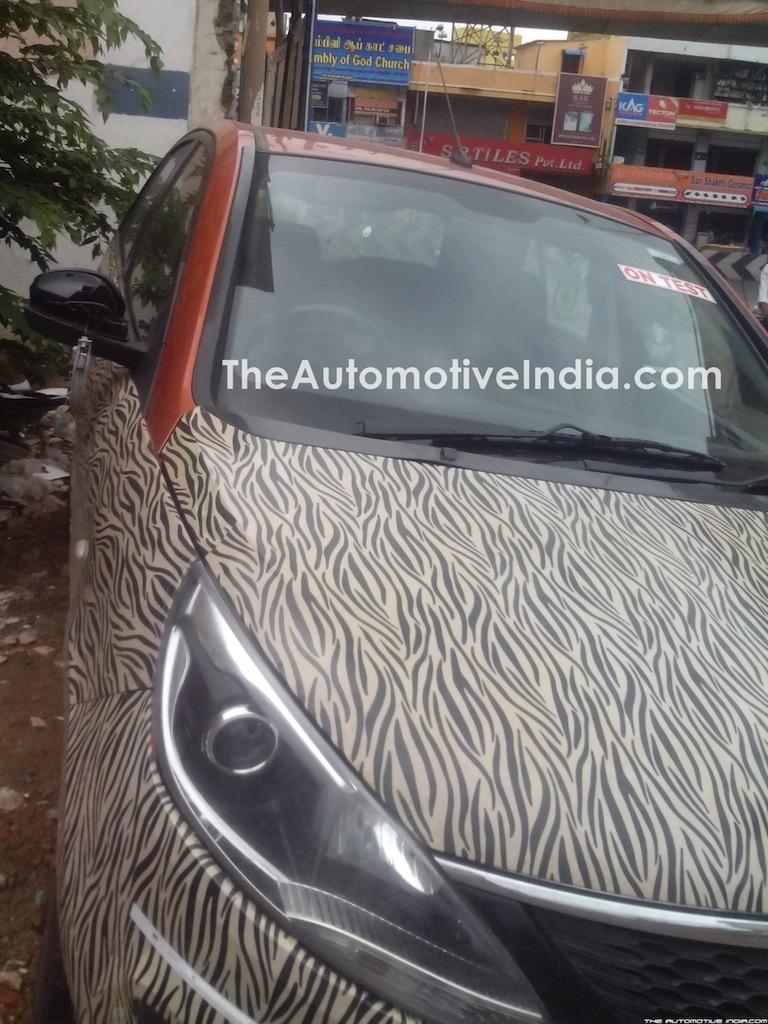 Tata Bolt with orange interior spied headlight
