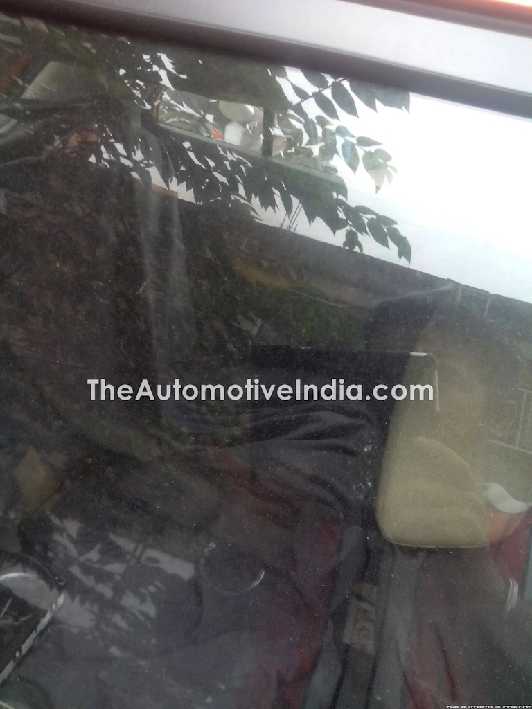 Tata Bolt with orange interior spied rear seat