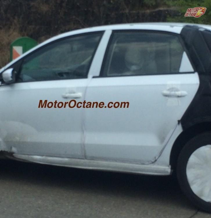 VW Vento facelift windows camouflaged test mule