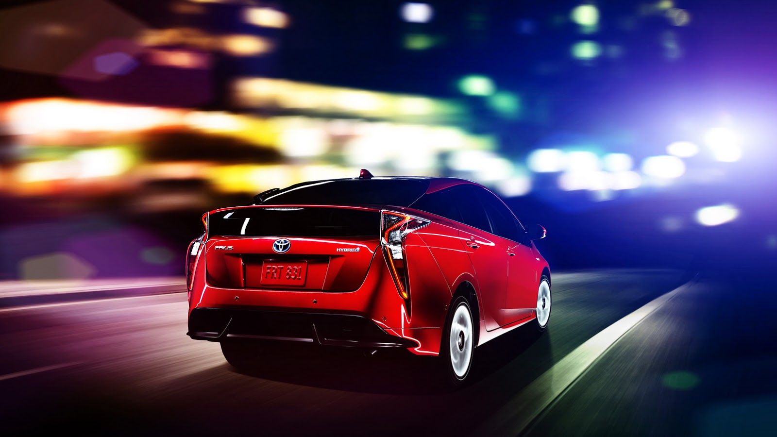 2016 Toyota Prius red rear three quarters North American specification official image