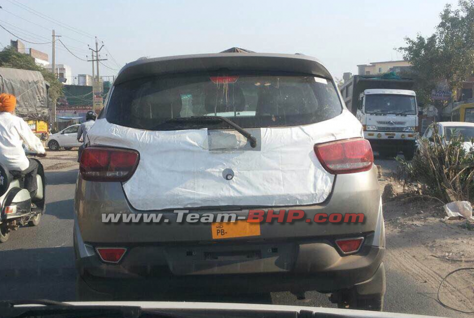 Mahindra XUV100 (S101) rear spotted with minimal camouflage