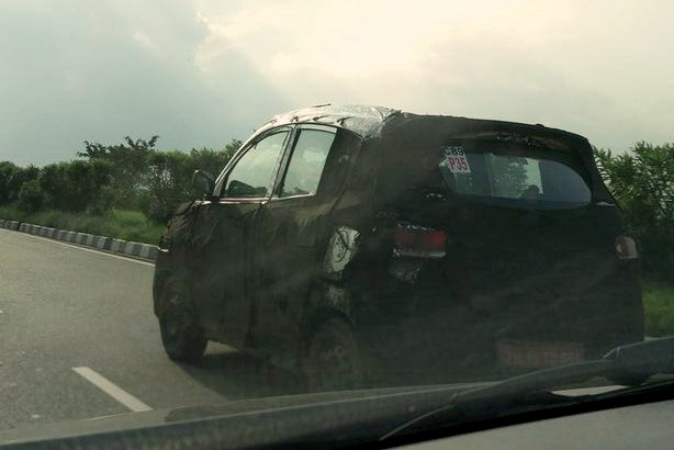 Mahindra S101 camouflaged prototype side spied