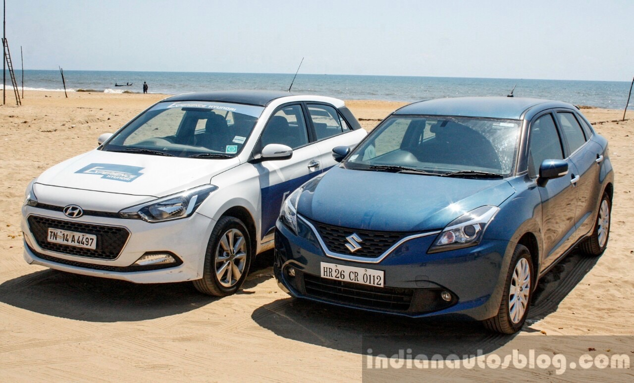 Maruti Baleno vs Hyundai Elite i20 front quarter left Comparison Review