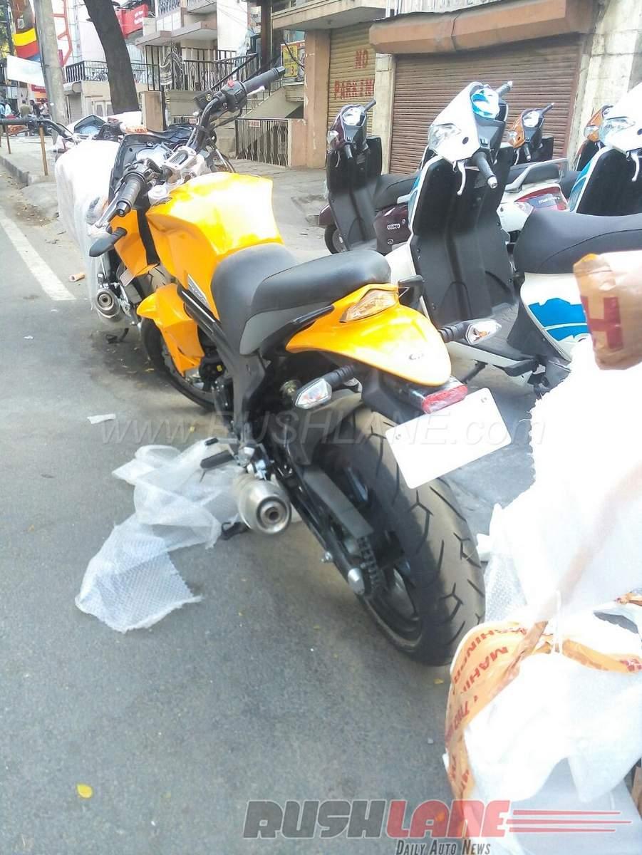 Mahindra Mojo Sunburst Yellow rear at dealership