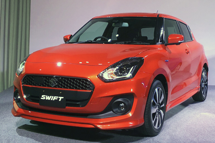 2017 Suzuki Swift red front three quarters left side launch event