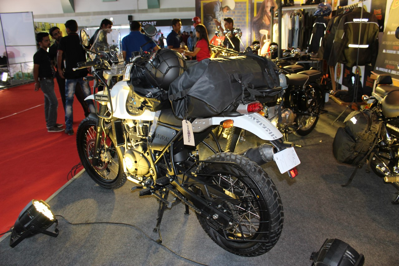 Royal Enfield Himalayan (accessorised) rear three quarters at Surat International Auto Expo 2017