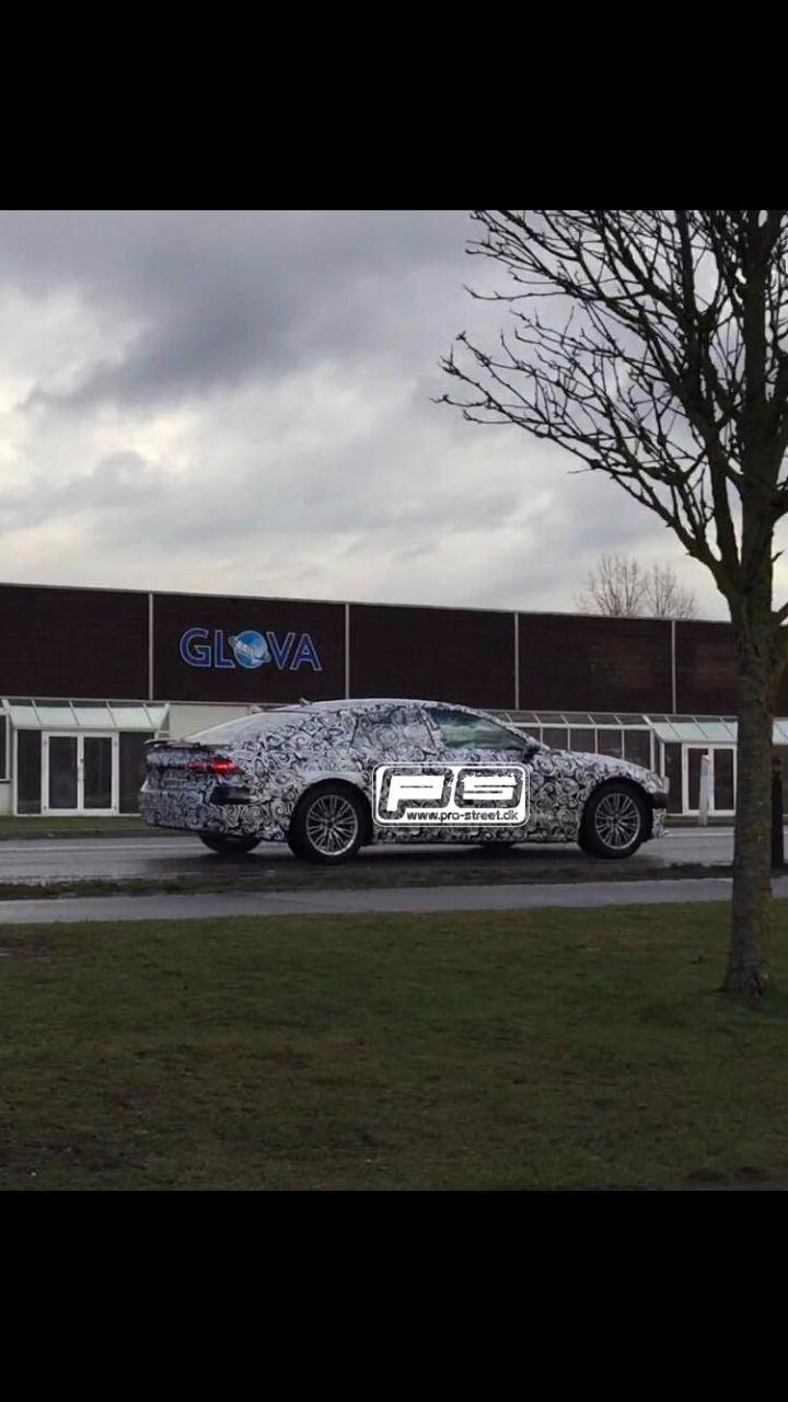 2018 Audi A7 rear three quarters right side spy shot