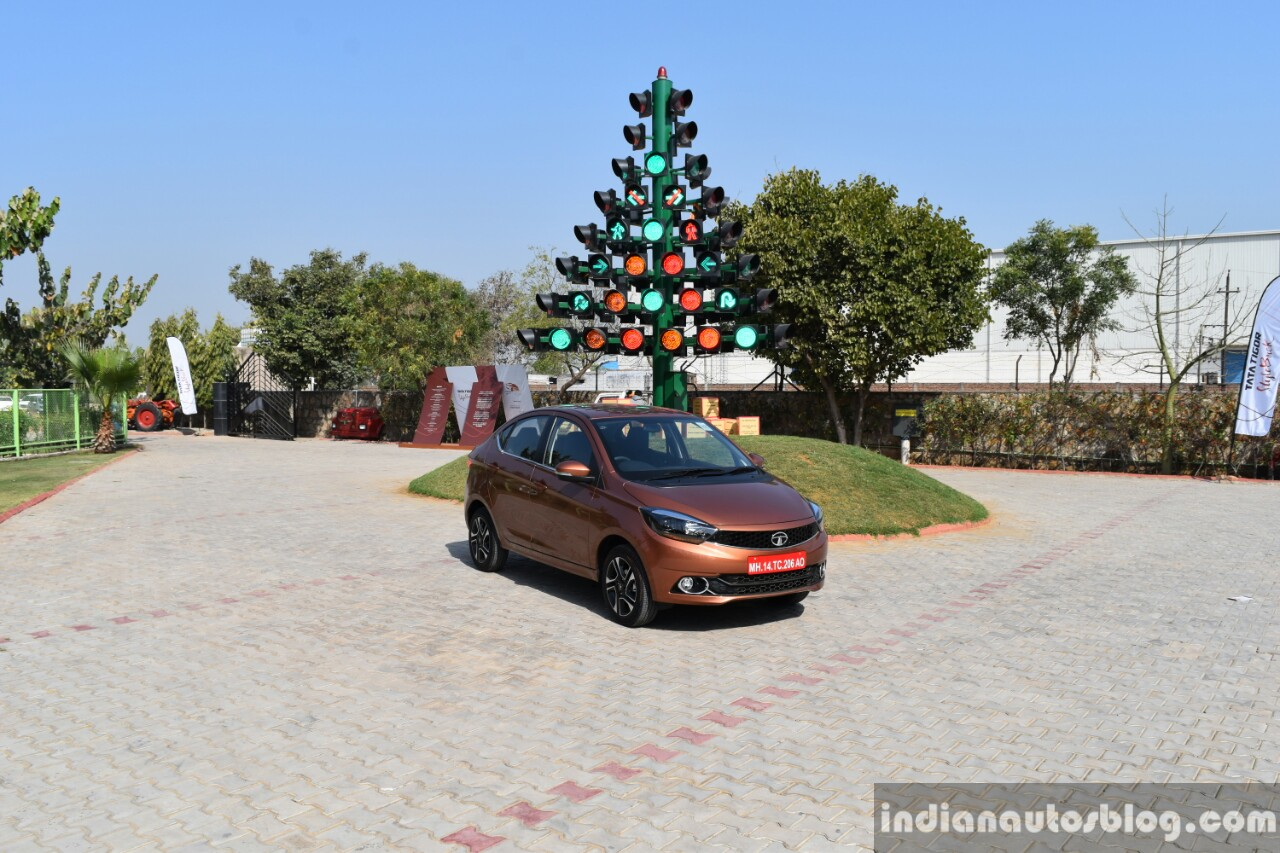 Tata Tigor petrol front quarter far First Drive Review
