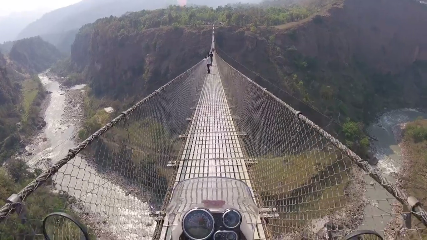 Royal Enfield Himalayan on a suspension bridge in Nepal