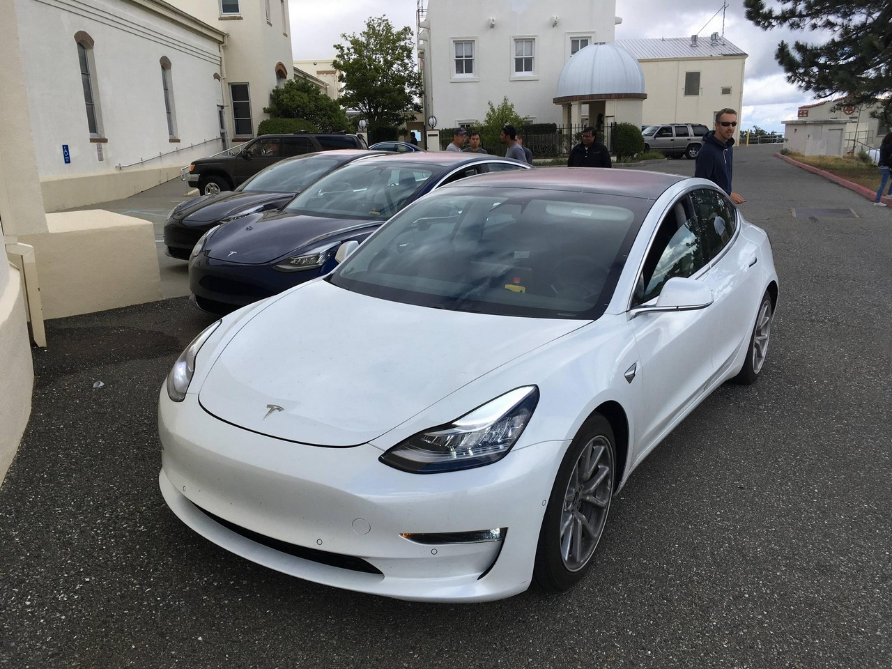 Tesla Model 3 white front three quarters left side spy shots