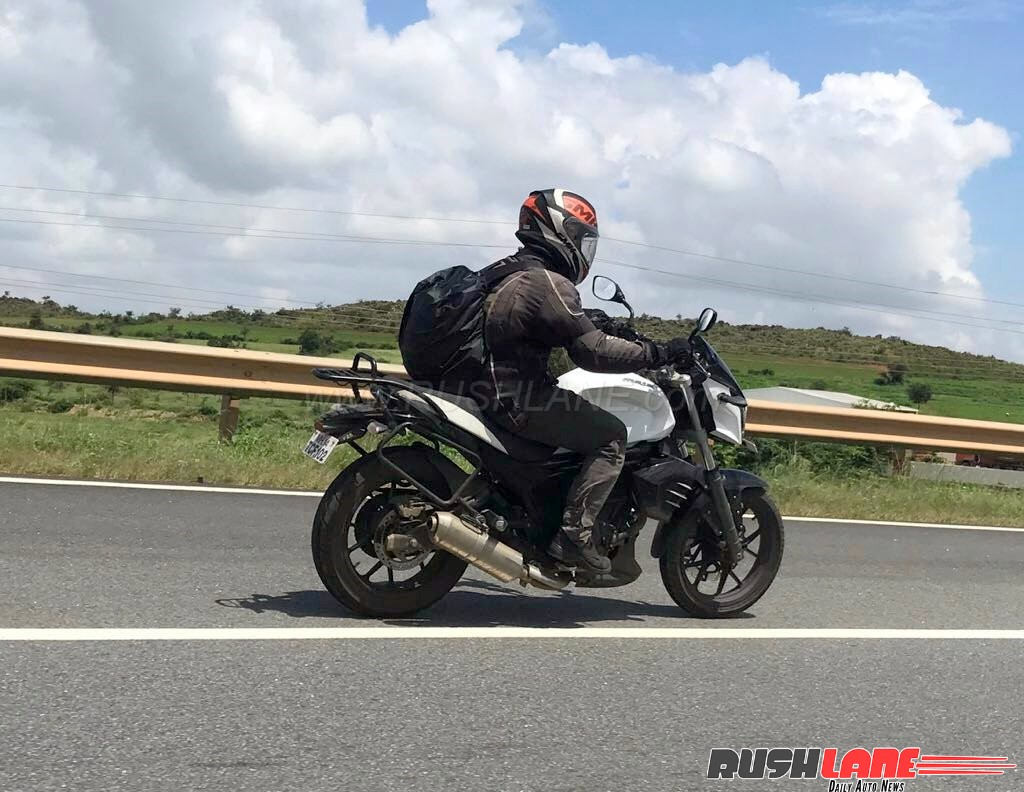 Low Cost Mahindra Mojo spied with accessories rear right quarter