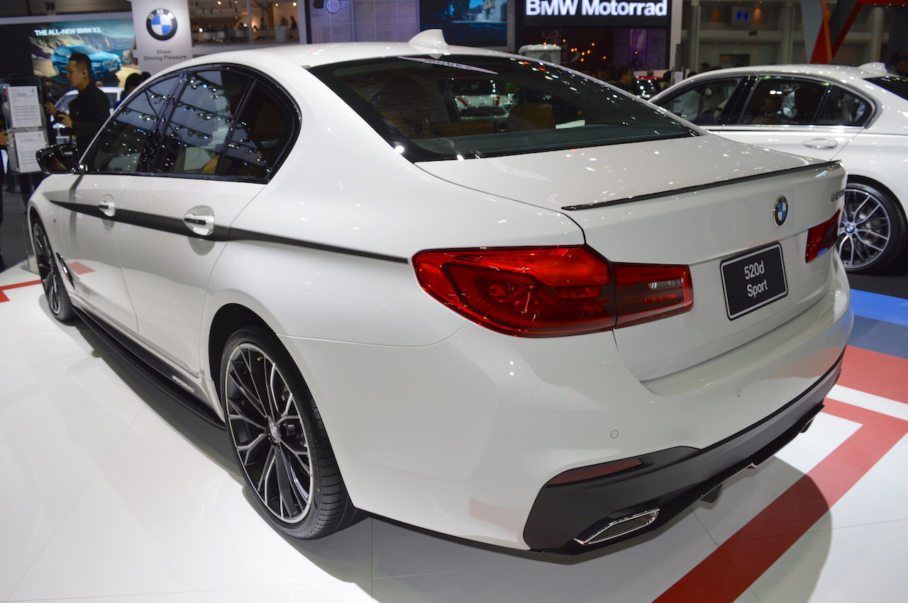 2017 BMW 5 Series with BMW M Performance accessories rear three quarters left side at 2017 Thai Motor Expo