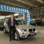 Mr.Juergen Eder Managing Director BMW Plant Chennai with the 20000th car rolling out from the assembly line at BMW Plant Chennai