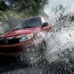 Tata Safari Storme splashes mud and water