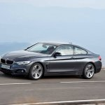 Front right three quarter angle of the grey 2014 BMW 4 Series Coupe