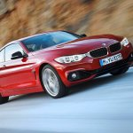 Front right three quarter angle of the red 2014 BMW 4 Series Coupe