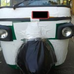 front of the 2013 Bajaj RE three wheeler spied
