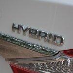 Toyota Camry Hybrid badge on boot door