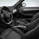 2015 BMW X1 high gloss black dashboard press shot