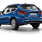 2015 BMW X1 rear three quarters left press shot