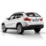 2015 BMW X1 rear three quarters left white press shot