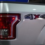 2015 Ford F-150 badge at NAIAS 2014
