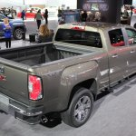 2015 GMC Canyon rear three quarters loading bay at NAIAS 2014