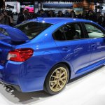 2015 Subaru WRX STi rear three quarter view at NAIAS 2014