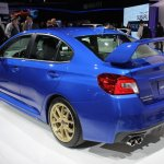 2015 Subaru WRX STi rear three quarters at NAIAS 2014