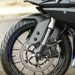 2014 Yamaha YZF-R125 front wheel detail press shot