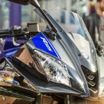 2014 Yamaha YZF-R125 headlamp detail press shot