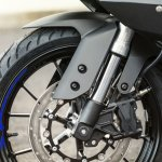 2014 Yamaha YZF-R125 inverted rod front suspension detail press shot