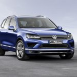 2015 VW Touareg front three quarters left press shot