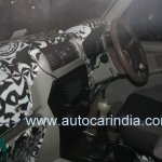 Spied interiors of the 2014 Mahindra Scorpio facelift dashboard