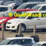 Maruti Swift facelift spied India Red