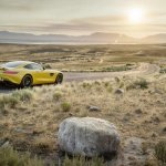 Mercedes AMG GT press image yellow rear three quarter