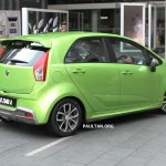 Proton Iriz driven by Dr. Mahathir Mohamad rear three quarter right