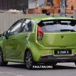Proton Iriz driven by Dr. Mahathir Mohamad rear three quarter
