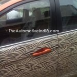 Tata Bolt with orange interior spied front door