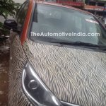 Tata Bolt with orange interior spied headlight