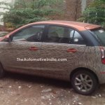 Tata Bolt with orange interior spied side