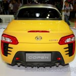 Yellow Daihatsu Copen rear at the Indonesia International Motor Show 2014