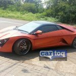 DC Avanti orange spied front three quarter