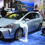 2015 Toyota Prius v front three quarters right at the 2014 Los Angeles Motor Show
