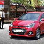 Hyundai Grand i10 Sedan (Xcent) front three quarter press shot