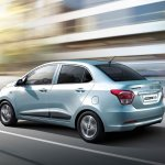 Hyundai Grand i10 Sedan (Xcent) in motion press shot