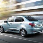 Hyundai Grand i10 Sedan (Xcent) in motion press shot
